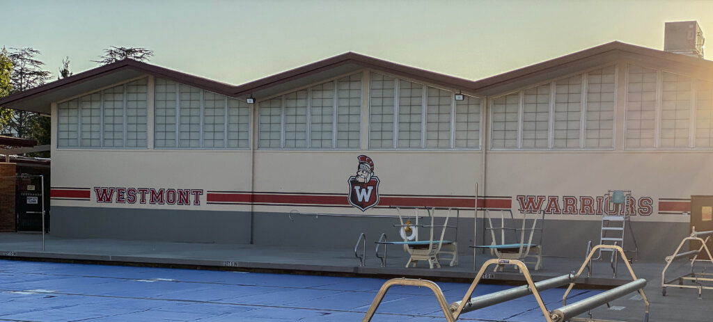 San Jose school signs westmont high pool paint mural mascot