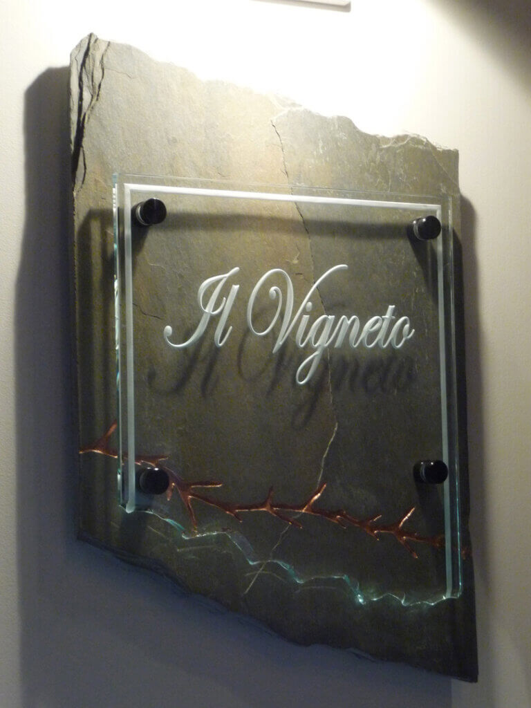 San Martin restaurant sign for il vigneto made of glass and stone