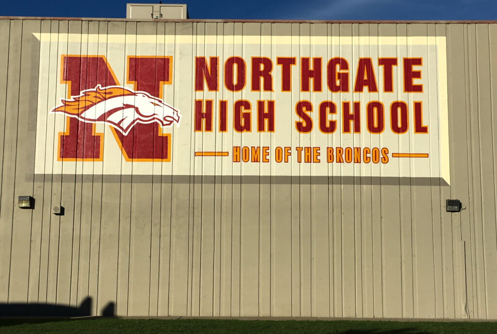 custom school signs Walnut Creek northgate high gym exterior mascot painting after