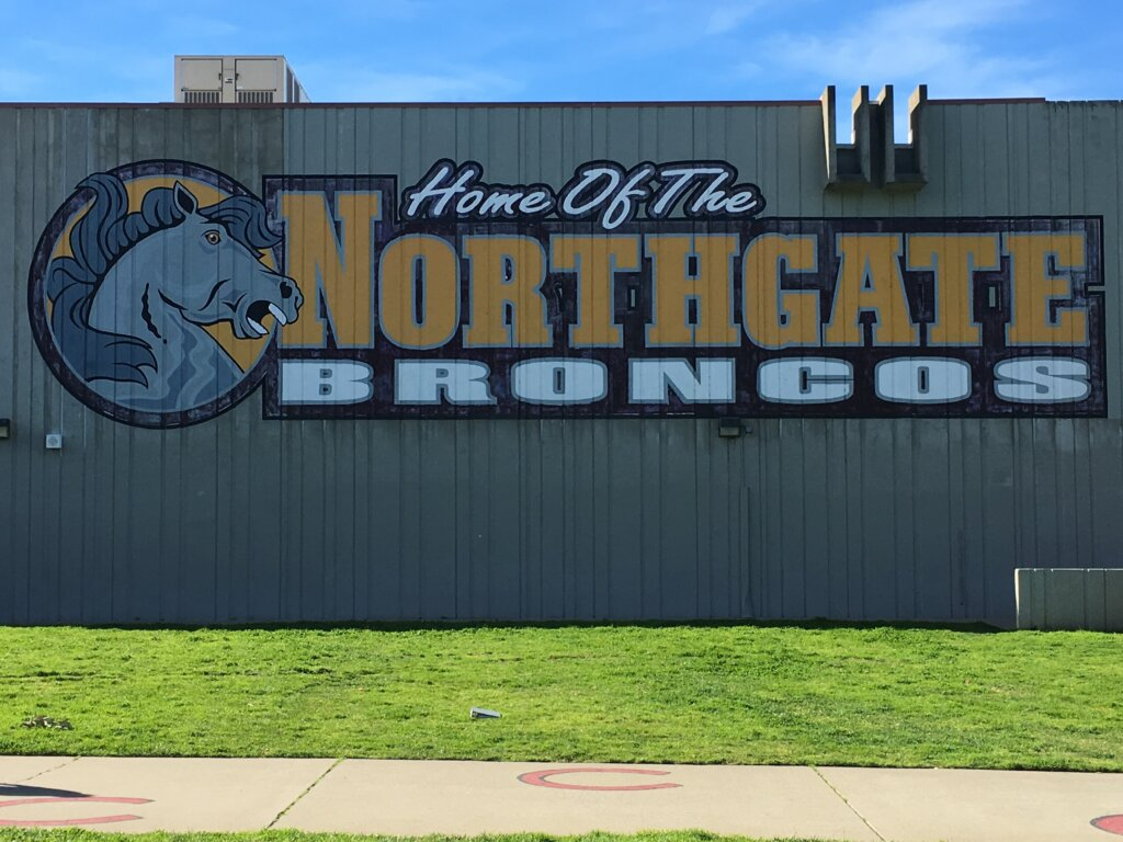 custom school signs Walnut Creek northgate high gym exterior mascot painting before