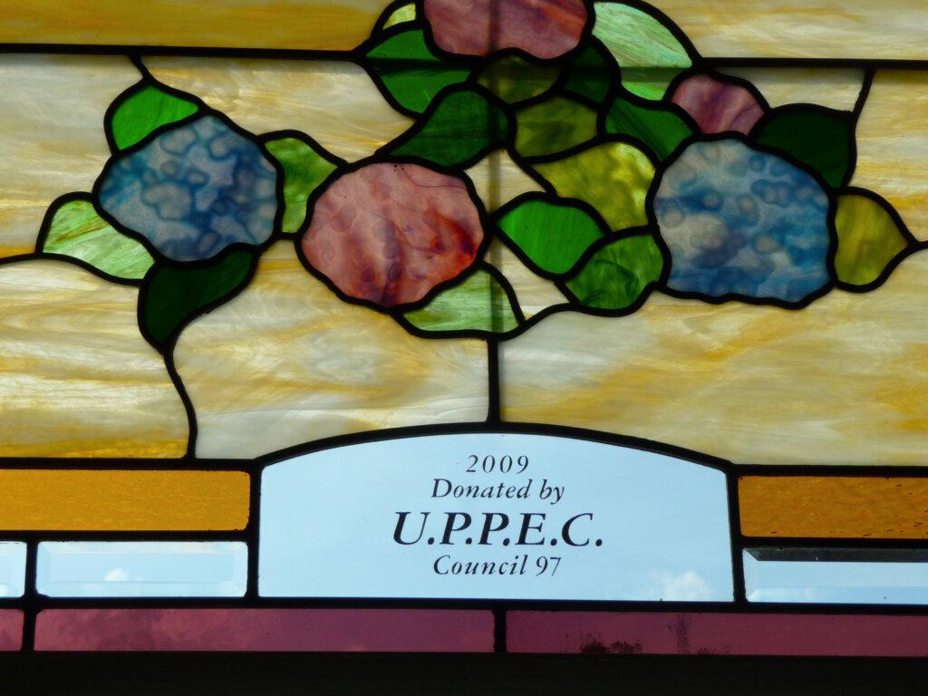 stained glass Chowchilla church sociedade flor acoriana chapel window detail california